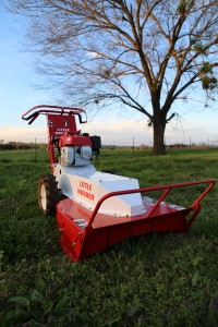 The Little Wonder BRC26 Hydro Brush Cutter mows heavy thick growth, thicket and brush and cuts saplings up to two inches thick.