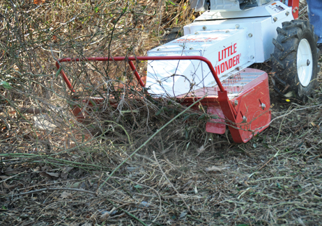 Hydro Brush Cutter closeup clearing overgrowth